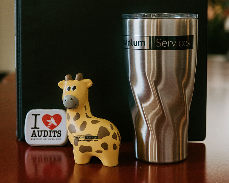 Quantum giraffe with coffee mug and sticker